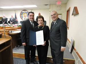 With the board of  commissioners and public offering a standing ovation, Aston Commissioners President Jim Stigale presented Neumann University President Dr. Rosalie Mirenda and her husband Tony, with a proclamation in recognition of the 50th anniversary of  the founding of the university.