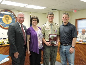 Aston Commissioner Mark Osborn presented Eagle Scout Darren Sereikis with a proclamation during a recent meeting of the board of commissioners. Also pictured are Darren's mother, Cindy; and father Michael.