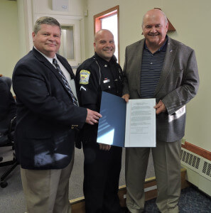 Thomas J. Giancristoforo, Jr. was named Aston Township Police Officer of the year. He is pictured with Police Chief Daniel Ruggieri and 5th Ward Commissioner Jim McGinn. Photo by Loretta Rodgers