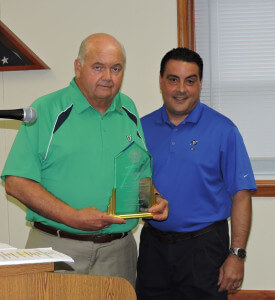 Aston Commissioners President Jim Stigale presented nine-term commissioner Jim McGinn with a service award for his dedication to the township.   Photo by Loretta Rodgers