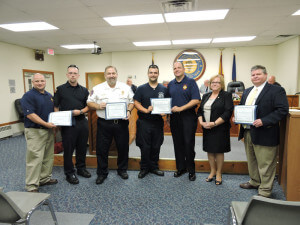 Aston Commissioner Carol Graham presented certificates of recognition to ATFD Chief Michael Evans, ATFD EMT Tony Cirino, CKHS Chief Paramedic Robert Reeder, ATFD EMT John Gibson Jr., ATFD EMS Captain Bruce Egan, and Aston Police Chief Dan Ruggieri. Photo by Loretta Rodgers
