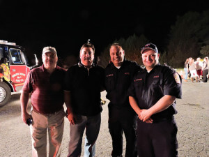Aston Commissioner Mike Higgins poses with Joe McColgan, township planning commission chairman; ATFD President Sean Joyce, and AFTD Fire Chief Mike Evans - by Loretta Rodgers