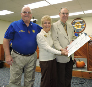 Bill and Ann Nixon  with Commissioner Mike Higgins
