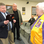 With Aston Commissioner Jim McGinn looking on, Police Chief Dan Ruggieri presented a plaque of gratitude to Harriet Reynolds, president of the Aston Lioness Club.  Photo by Loretta Rodgers