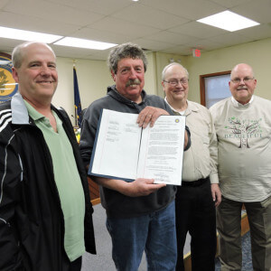 Aston Township public works employee Ron Cross was presented a proclamation on the event of his retirement. Pictured with Cross is Commissioner Mike Higgins ( far right), public works supervisor Russ Palmore and former township secretary/manager Dick Lehr.