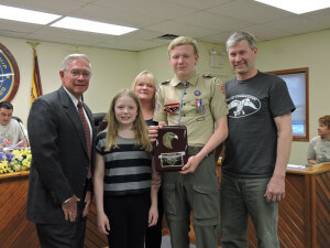 Aston Commissioner Mark Osborn, during the April 15 meeting of the board of commissioners, presented new Eagle Scout Stephen Taylor with a proclamation. Also pictured are Stephen's mother, Lori; father Frank; and sister, Catherine.