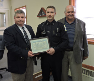 Aston Township Police Officer Joseph Hart was presented a commendation of merit by Police Chief Dan Ruggieri and 5th Ward Commissioner Jim McGinn during the May 20 meeting of the Aston Board of Commissioners. Photo by Loretta Rodgers