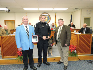 Aston Police Chief Dan Ruggieri, Officer Mikell Jones and his K-9 partner Jax, showed their sincere appreciation to the Media Moose Lodge #2189 by presenting Lodge Administrator Dave Linahan with a plaque of gratitude. photo by Loretta Rodgers