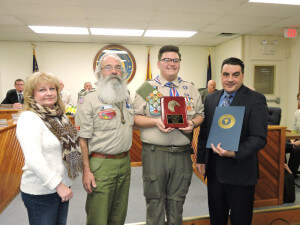 Eagle Scout Casey Berardi is congratulated by his mother, Lee Berardi, Scout Leader Glen Clark and Aston Commissioner's President Jim Stigale. Photo by Loretta Rodgers