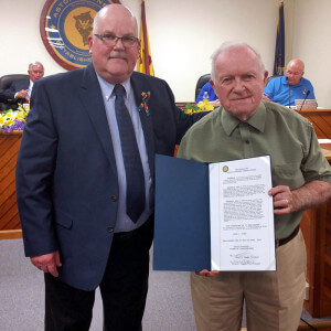 Aston 7th Ward Commissioner Mike Higgins, om behalf of the board, presented 55-year resident John C. Ford with a proclamation in recognition of Ford's 96th birthday.  Photo by Loretta Rodgers