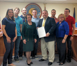 Aston 2nd Ward Commissioner Carol Graham (right) presented the Neumann University Knights Roller Hockey team with  proclamation for capturing the national title. Pictured with the team is their coach Lee Strofe and Neumann University President Dr. Rosalie Mirenda.   Photo by Loretta Rodgers