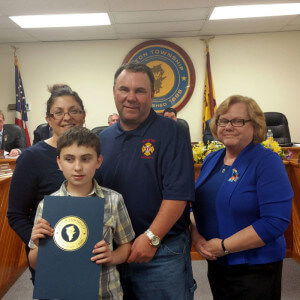 Aston 2nd Ward Commissioner Carol Graham presented Robert and Donna Herre and their son, Stephen, with a proclamation for all the tremendous work the family has done in the area of Autism Awareness. Photo by Loretta Rodgers