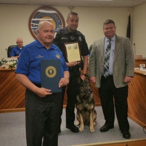 Aston Commissioner Jim McGinn and Police Chief Dan Ruggieri presented a proclamation and plaque to Officer Mikell Jones, who accepted on behalf of K-9 Jax. Photos by Loretta Rodgers